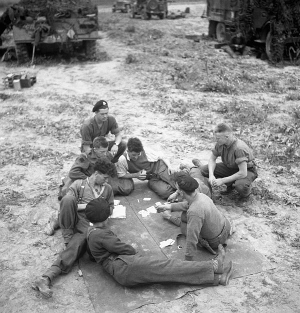 Troopers of the 12th Manitoba Dragoons playing cards near Caen, France, 19 July 1944.