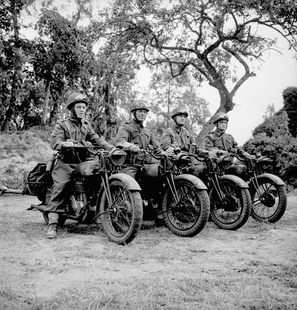 Personnel of the Cameron Highlanders of Ottawa on motorcycles near Caen, France, 15 July 1944.