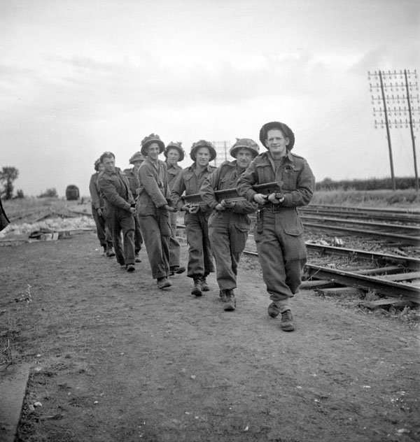 Sappers of the 16th Field Company, Royal Canadian Engineers (R.C.E.), removing a damaged rail from the Paris-Cherbourg railway line near Carpiquet, France, 8 July 1944.