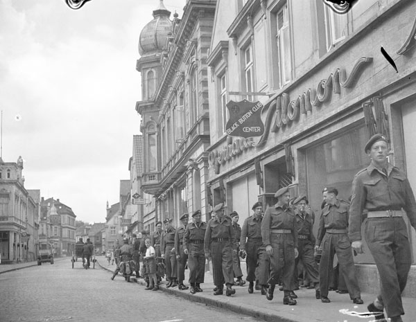 Soldiers of the Canadian Army Occupation Force (C.A.O.F.) walking around Aurich, Germany, ca. 26-27 August 1945.