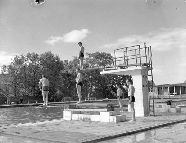 A swimming pool which has been taken over by the Canadian Army Occupation Force (C.A.O.F.), Aurich, Germany, ca. 26-27 August 1945.