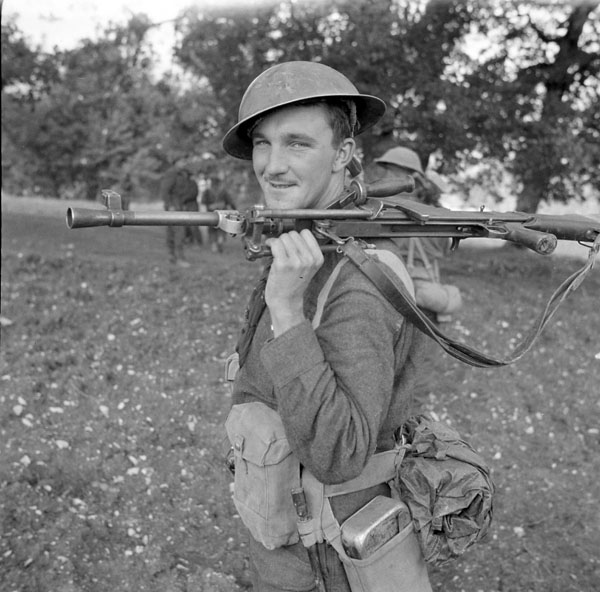 Private D.B. MacDonald of The Royal Canadian Regiment, who carries a Bren light machine gun, near Campobasso, Italy, October 1943.