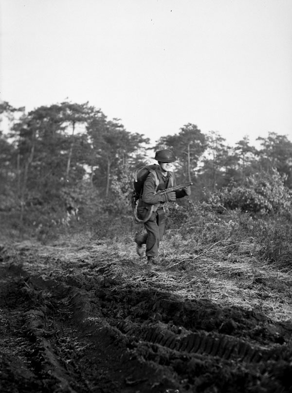 Private W. Smith of The Highland Light Infantry of Canada training to operate a Lifebuoy flamethrower, Nijmegen, Netherlands, 14 December 1944.