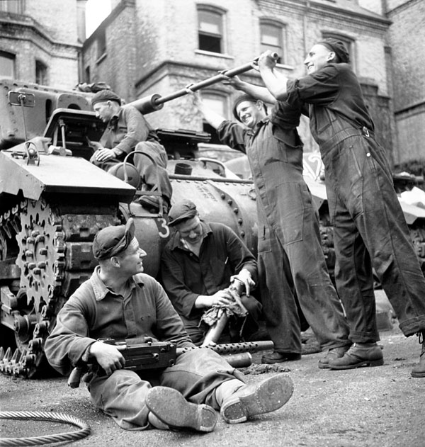 Unidentified troopers of The British Columbia Regiment servicing their Ram II tank, England, 15 July 1943.