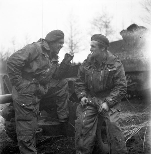 Privates Hector and Bertrand Viens of Les Fusiliers Mont-Royal, brothers who are both serving in the same Universal Carrier crew, north of Laren, Netherlands, 6 April 1945.