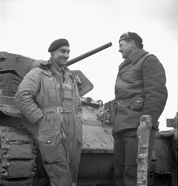 Sergeant P. Harrison and Lieutenant J. Swainson with a Sherman tank of The Fort Garry Horse, which was the first Canadian tank to enter Germany, in the Hochwald, Germany, 3 March 1945.