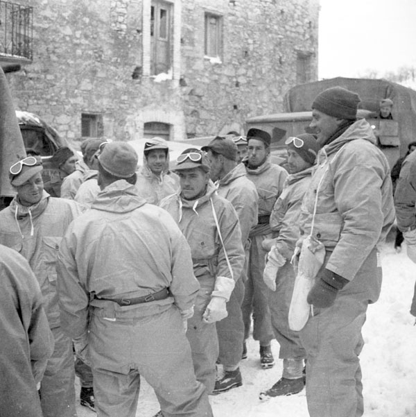Troopers of The Ontario Regiment moving forward, Atessa, Italy, 21 February 1944.