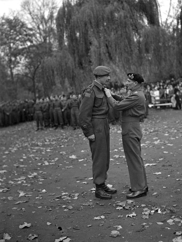 Field Marshal Sir Bernard Montgomery decorating A/Lieutenant-Colonel L.R. Fulton, Commanding Officer of The Royal Winnipeg Rifles, with the Distinguished Service Order, Ghent, Belgium, 5 November 1944.