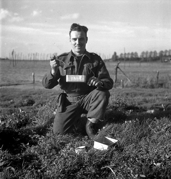Private M. Therrien of The Black Watch (Royal Highland Regiment) of Canada eating supper, South Beveland, Netherlands, 30 September 1944.