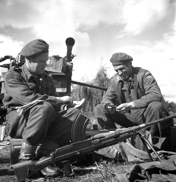 Lance-Bombardier R.G. Laidman and Gunner D. Rodgers of the 3rd Light Anti-Aircraft Regiment, Royal Canadian Artillery (R.C.A.), playing cribbage near Antwerp, Belgium, 30 September 1944.