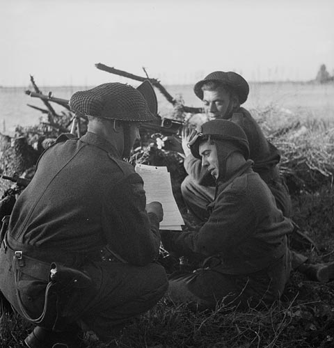 Infantrymen of The Black Watch (Royal Highland Regiment) of Canada purchasing Victory Bonds, South Beveland, Netherlands, 30 September 1944.