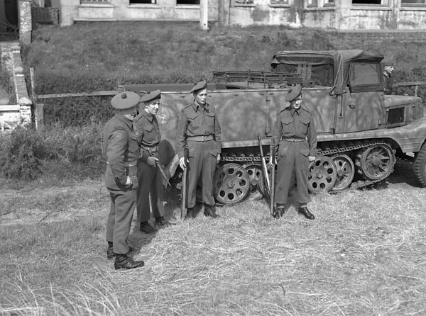 Canadian personnel with the German halftrack vehicle which transported them around Norderney during surrender negotiations, Norderney, Germany, 8 May 1945.