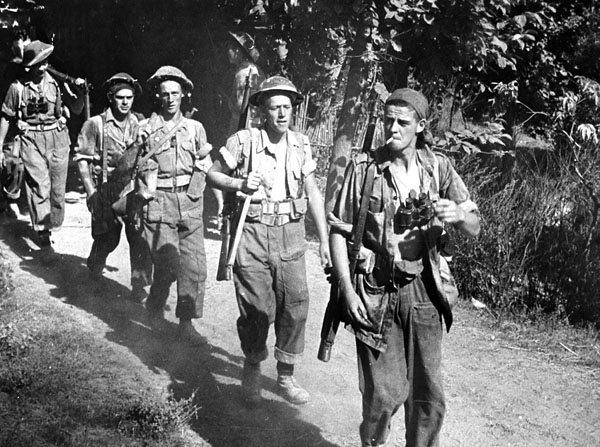Infantrymen of The 48th Highlanders of Canada advancing towards the Gothic Line near the Foglio River, Italy, 1944.