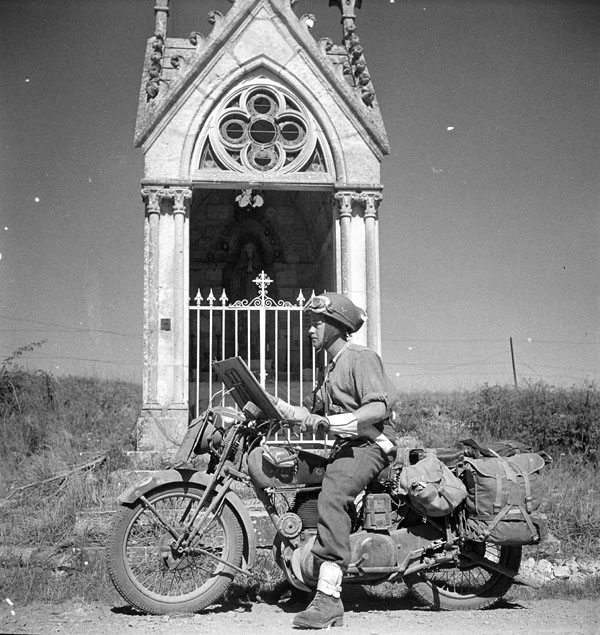 Lance-Corporal Don Fife of No.2 Provost Company, Canadian Provost Corps (C.P.C.), on a motorcycle en route to Falaise. Fresney-le-Puceau, France, 12 August 1944.