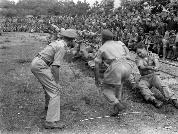 The tug-of-war team of The West Nova Scotia Regiment in action during the final pull against the team of The Saskatoon Light Infantry (M.G.) during the 1st Canadian Infantry Division's Track and Field Championships, Telese, Italy, 24 June 1944.