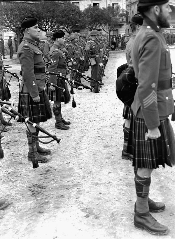 Soldiers of the Seaforth Highlanders of Canada and the Lorne Scots taking part in the Changing of the 1st Canadian Corps Guard ceremony, Rocca, Italy, 1 March 1944.