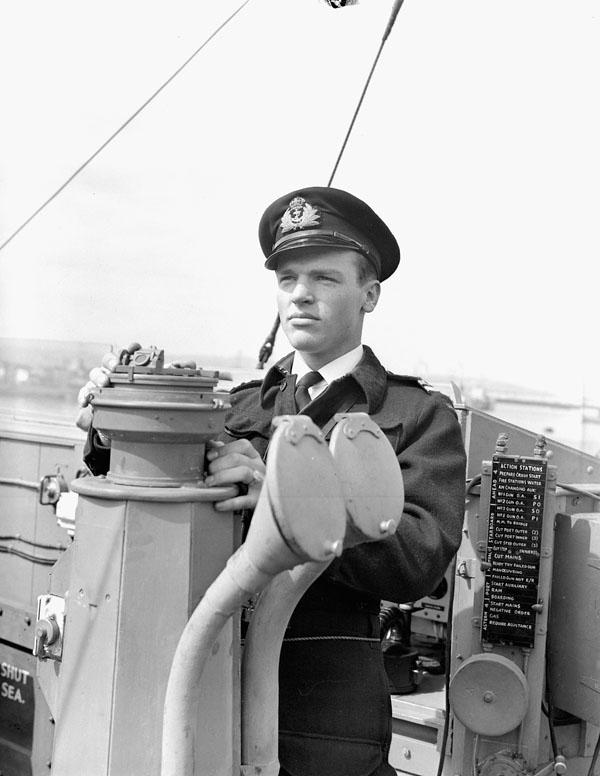 Lieutenant David B. Wilson, Royal Canadian Naval Volunteer Reserve (R.C.N.V.R.), Navigator, Motor Torpedo Boat (MTB) 748 of the 65th MTB Flotilla, Royal Navy, England, 25 May 1944.