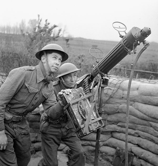 Infantrymen of an unidentified Canadian regiment with a pivot-mounted Vickers machine gun during an anti-aircraft training exercise, England, April 1943.