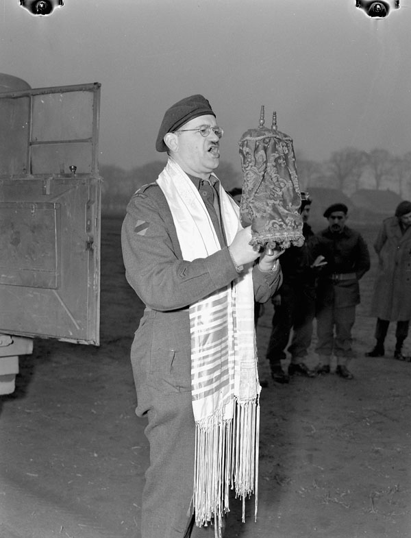 H/Captain Samuel Cass, a rabbi, conducting the first worship service celebrated on German territory by Jewish personnel of the 1st Canadian Army near Cleve, Germany, 18 March 1945.