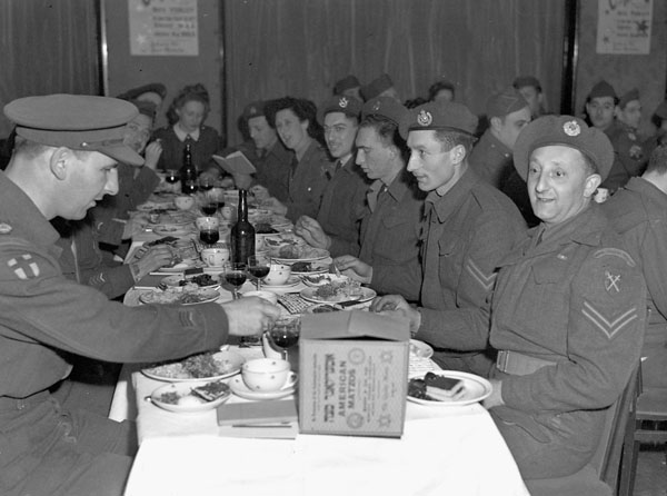 Jewish personnel of the 1st Canadian Army celebrating a Passover Seder meal, Brussels, Belgium, 29 March 1945.
