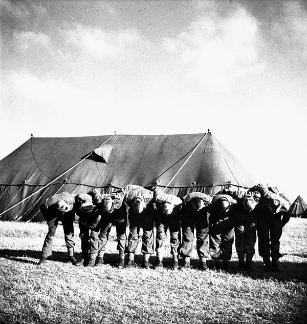 Paratroopers of the 1st Canadian Parachute Battalion who shaved the letters V-I-C-T-O-R-Y on their heads during their stay at a transit camp in England before parachuting into France. England, ca. 1-5 June 1944.