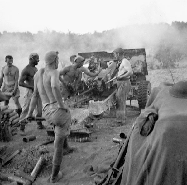Gunners of the 7th Battery, 2nd Field Regiment, Royal Canadian Artillery (R.C.A.), firing their 25-pounder guns at German positions, Nissoria, Italy, 23-28 July 1943.