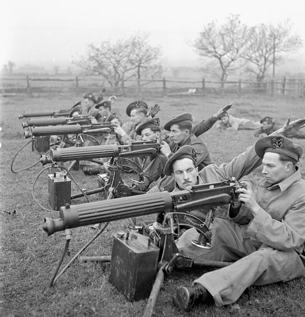 Infantrymen of the Seaforth Highlanders of Canada taking part in a Vickers machine gun training course, England, 3 December 1942.