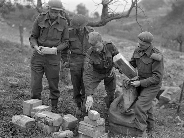 Sorting of mail for personnel of the Loyal Edmonton Regiment near Ortona, Italy, 21 December 1943.