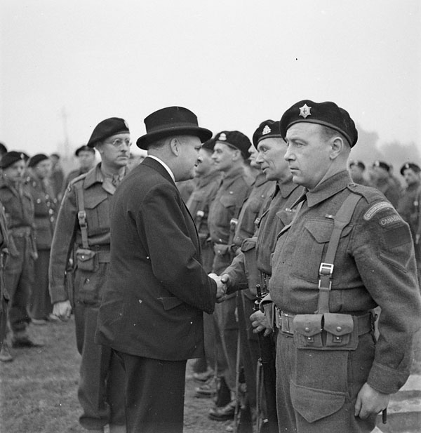 Major-General C.B. Price talking with Corporal T.J. Brennan during the disbandment parade of the Royal Montreal Regiment, Seaford, England, 16 March 1944.
