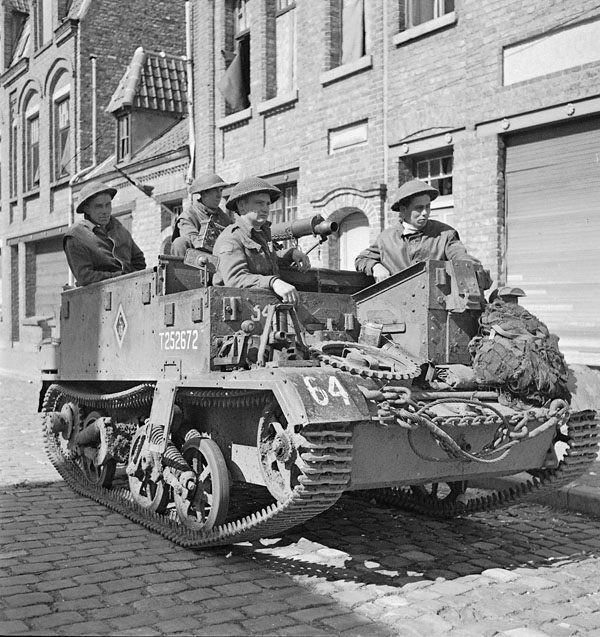 Infantrymen of the Toronto Scottish Regiment in their Universal Carrier waiting to move forward, Nieuport, Belgium, 9 September 1944.