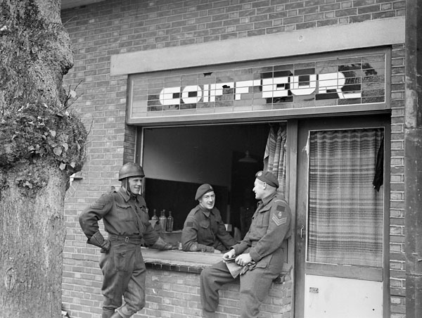 Personnel at the temporary office of the 8th Field Squadron, Royal Canadian Engineers (R.C.E.), Calmpthout, Belgium, 23 October 1944.