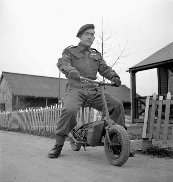 Sergeant Gordon Davis of the 1st Canadian Parachute Battalion, riding a Welbike lightweight motorcycle used by airborne forces, Carter Barracks, Bulford, England, 5 January 1944.