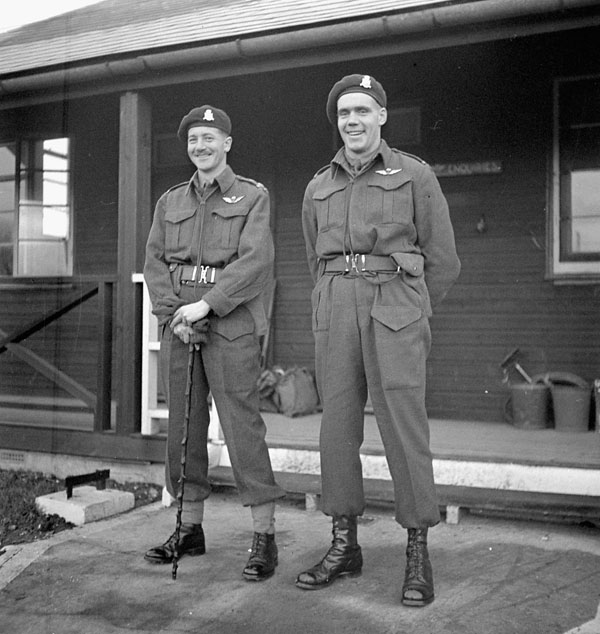 Lieutenant-Colonel G.F.P. Bradbrooke, Commanding Officer of the 1st Canadian Parachute Battalion, and his Deputy Commander, Major Jeff A. Nicklin, outside Battalion Headquarters, Carter Barracks, Bulford, England, January 1944.