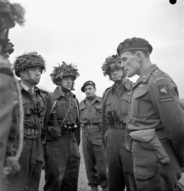 Brigadier S. James L. Hill (right), Commander of the 3rd Parachute Brigade, briefs officers of the 1st Canadian Parachute Battalion, Carter Barracks, Bulford, England, 6 December 1943.