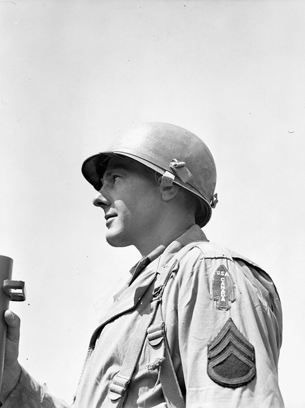 Unidentified sergeant of the First Special Service Force, wearing the distinctive USA-CANADA spearhead shoulder title, Anzio beachhead, Italy, 20 April 1944.