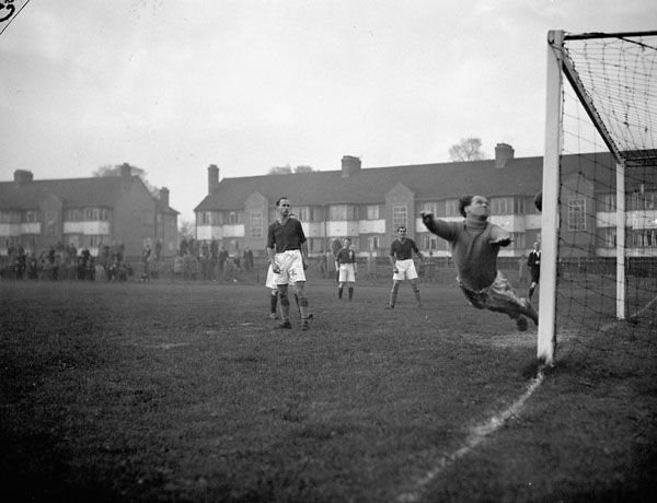 Norway's goalkeeper A. Borgen stopping a Canadian shot during a Canada - Norway charity soccer match to benefit St. Dunstan's School, Harrow, England, 28 October 1944.