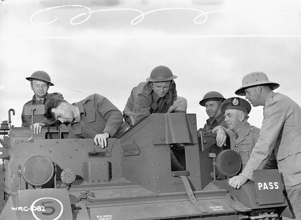 Officers of The Cape Breton Highlanders examining a Universal Carrier during a training course at the Connaught Ranges, Ottawa, Ontario, Canada, 1941.