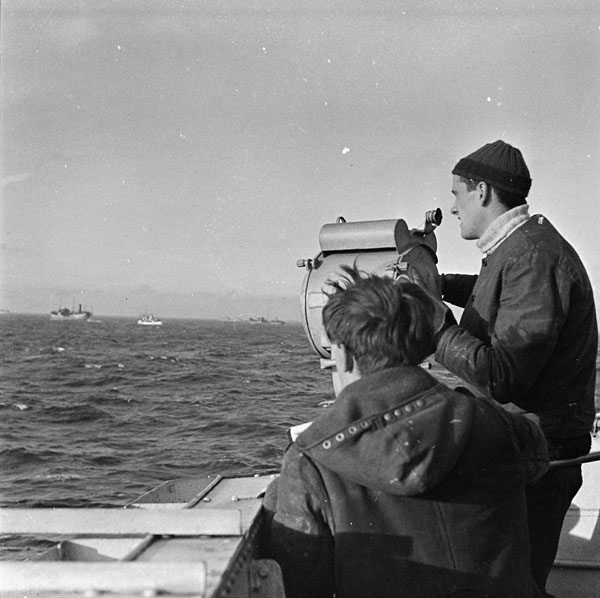 Signalmen aboard  H.M.C.S. KITCHENER, which is at sea escorting a convoy en route to Liverpool, October 1942.