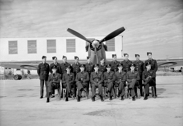 Personnel with a Hawker Hurricane XII aircraft of No.130(F) Squadron, R.C.A.F. Station Bagotville, Québec, Canada, 21 October 1942.