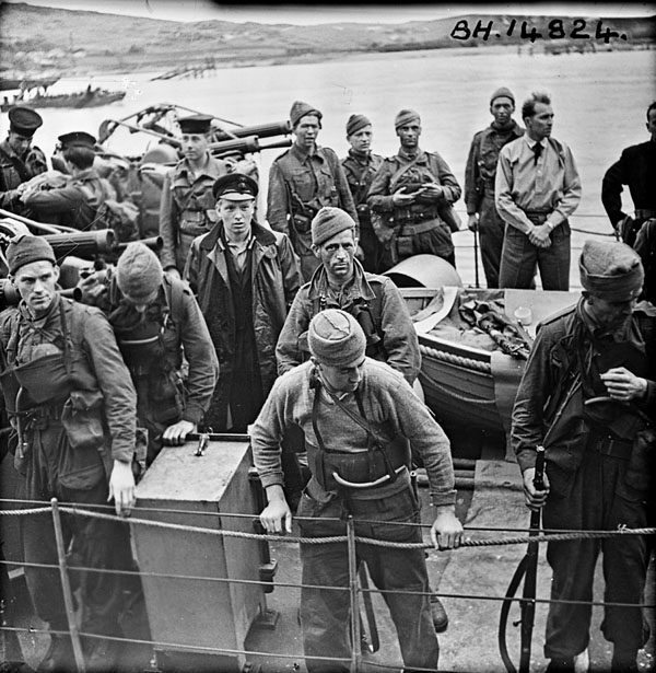 German soldiers who were captured during Operation JUBILEE, the raid on Dieppe, disembarking in England, 19 August 1941.