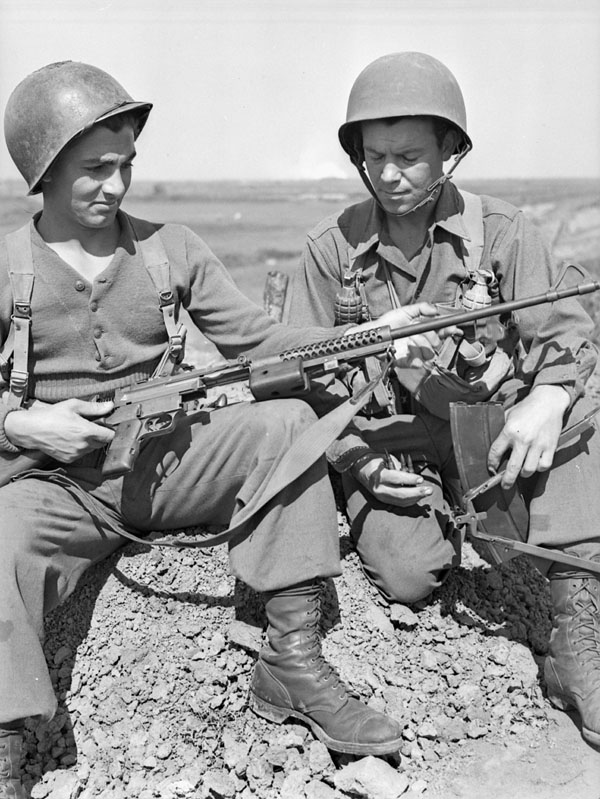 Forcemen of 5-2, First Special Service Force, with an M41 Johnson light machine gun, Anzio beachhead, Italy, ca. 20-27 April 1944.
