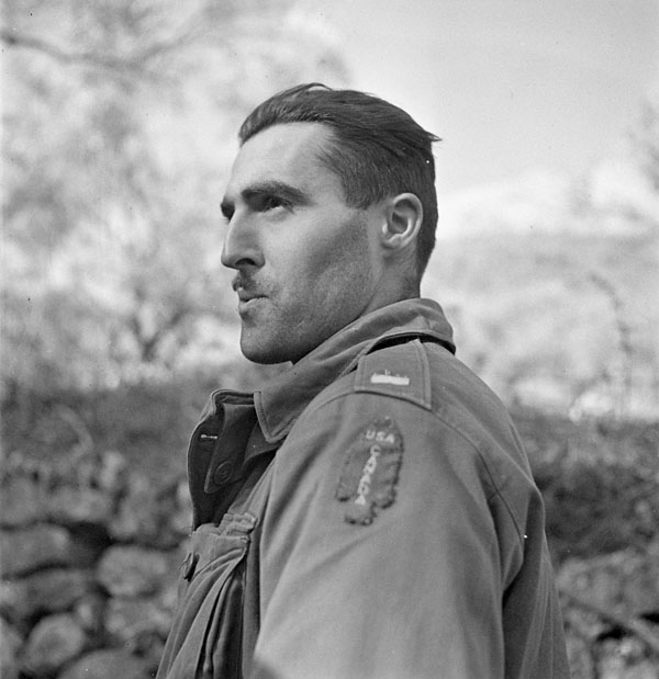 """Lieutenant J. Kostelec, who is wearing the """"U.S.-Canada"""" shoulder title worn by all members of the First Special Service Force, Noci, Italy, 2 January 1944."""