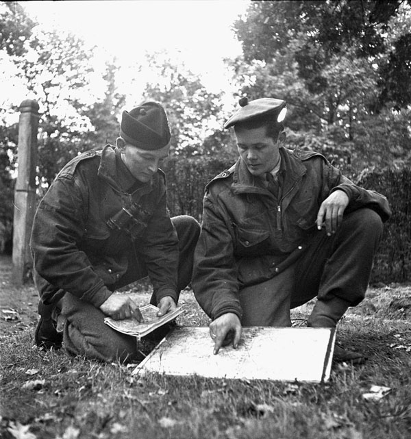 Lieutenant W.C.Pearson (right) briefing Sergeant P.A. Rylaasden, both of the Scout Platoon, Queen's Own Cameron Highlanders of Canada, Fort de Brasschaet, Belgium, 9 October 1944.