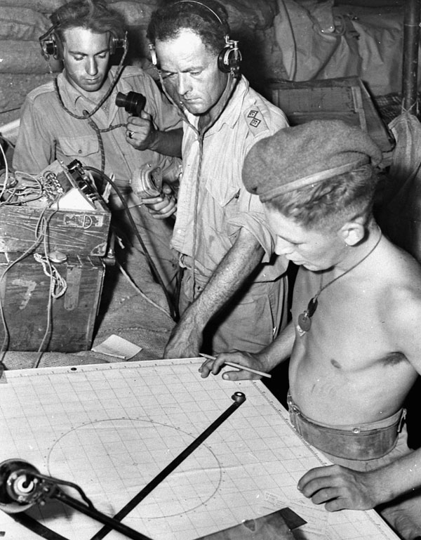 Personnel of the Royal Canadian Artillery (R.C.A.) plotting ranges for artillery during the assault on the Gothic Line, Italy, ca. 30-31 August 1944.