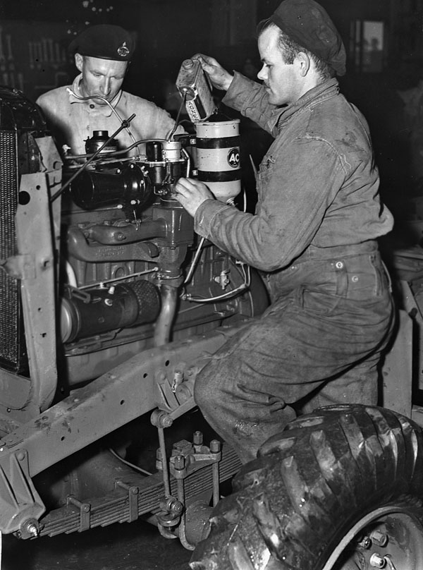 Personnel of the Essex Regiment test-running the engine of a vehicle being assembled in England, 27 January 1944.