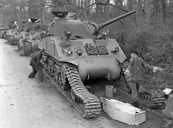 Waterproofing Sherman tanks of the Sherbrooke Fusiliers Regiment, England, 20 April 1944.