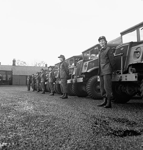 Drivers and ambulances of No.3 Section, Motor Ambulance Convoy, Royal Canadian Army Service Corps (R.C.A.S.C.), Farnborough, England, 12 January 1945.