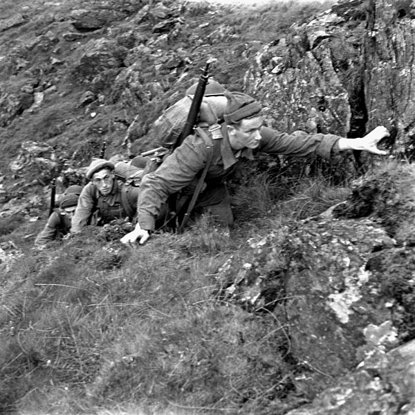 Unidentified infantrymen of the 1st Canadian Infantry Division taking part in a training exercise, Britain, May 1943.