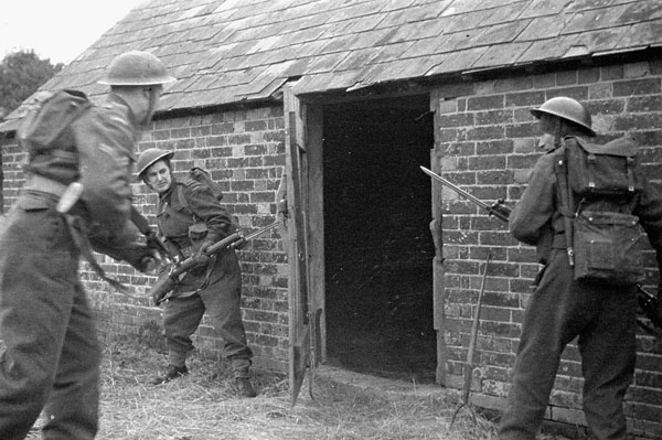 Infantrymen of the Essex Scottish Regiment taking part in a training exercise, England, 24 February 1942.