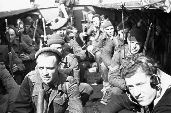 Infantrymen of an unidentified Canadian Scottish regiment in a landing craft during an assault landing training exercise, England, ca. 14-26 April 1942.